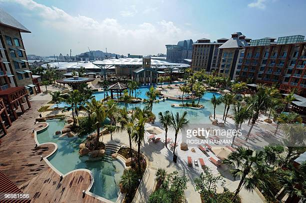 A general view shows a swimming pool from the Hard Rock hotel of the Resorts World Sentosa complex in Singapore on January 20 2010 Malaysian gaming...