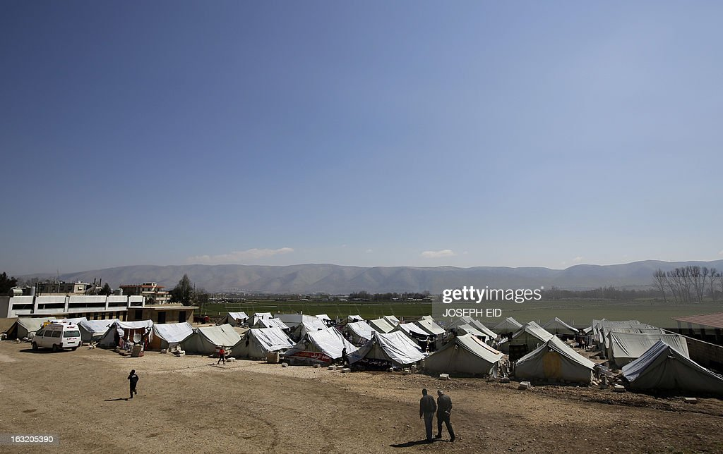 """A general view shows a Syrian refugee camp in the village of al-Marj in the Bekaa valley on March 6, 2013. The number of Syrians who have fled their war-ravaged country and are seeking assistance has now topped the 1 million mark, the UN refugee agency said Wednesday, warning that Syria is heading towards a """"full-scale disaster."""""""