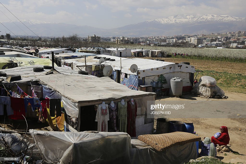 "A general view shows a Syrian refugee camp in the village of Saadnayel in the Bekaa valley on March 6, 2013. The number of Syrians who have fled their war-ravaged country and are seeking assistance has now topped the 1 million mark, the UN refugee agency said Wednesday, warning that Syria is heading towards a ""full-scale disaster."""