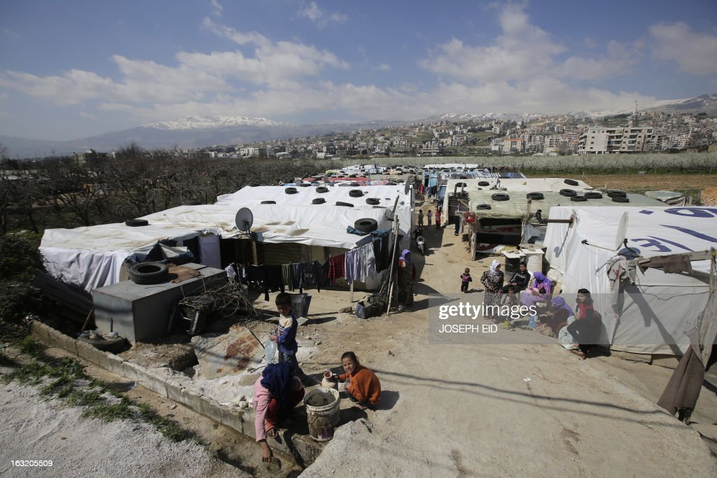 "A general view shows a Syrian refugee camp in the village of Saadnayel in the Lebanese Bekaa valley on March 6, 2013. The number of Syrians who have fled their war-ravaged country and are seeking assistance has now topped the 1 million mark, the UN refugee agency said, warning that Syria is heading towards a ""full-scale disaster."" AFP PHOTO/JOSEPH EID"