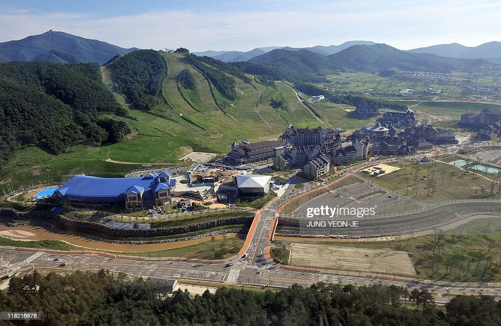 A general view shows Alpensia clustered with hotels and other winter sports facilities alongside ski slopes and a golf course in South Korea's...