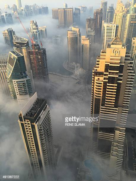 A general view shows an early morning fog surrounding the Grosvenor House hotel in Dubai and part of the city on October 5 2015 AFP PHOTO / RENE SLAMA