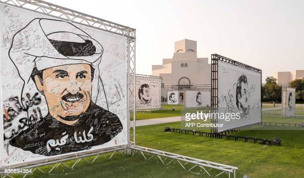 A general view shows an exhibition of artworks which were donated by members of the community depicting Qatari Emir Tamim bin Hamad alThani titled...
