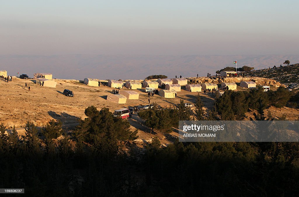 A general view shows an 'outpost' named Bab al-Shams ('Gate of the Sun') set up by Palestinian activists between Jerusalem and the Jewish settlement of Maale Adumim in the Israeli-occupied West Bank, in an area Israel said it would build thousands of new settler homes, on January 11, 2013. Six weeks ago, Israel announced plans to build thousands of settler homes in the largely uninhabited E1 area, in a move which sparked a global outcry. E1 falls within Area C of the West Bank which is under full Israeli civilian and security control and where Palestinians find it almost impossible to obtain building permits.