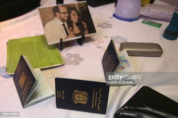 A general view shows belongings and the passports of the Abu Assaleh family in Damascus on January 30 2017 after they returned home after being...