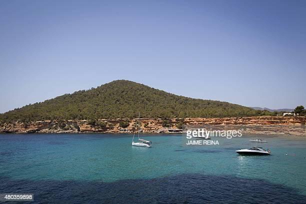 A general view shows boats at Sa Caleta beach in Sant Josep de sa Talaia on Ibiza Island on July 10 2015 AFP PHOTO/ JAIME REINA