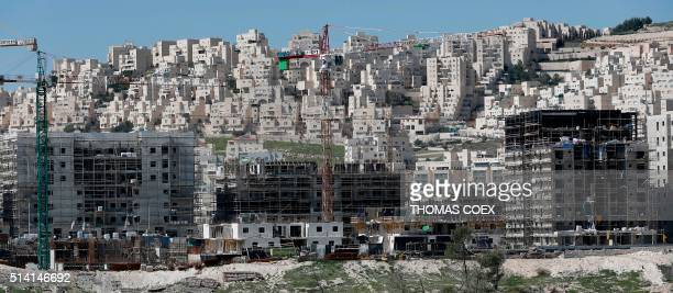 A general view shows buildings under construction in the Israeli settlement of Har Homa in annexed east Jerusalem on March 7 2016 / AFP / THOMAS COEX