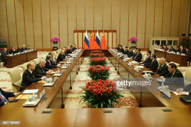 A general view shows Chinese President Xi Jinping and Russian President Vladimir Putin attend a bilateral meeting at Diaoyutai State Guesthouse in...