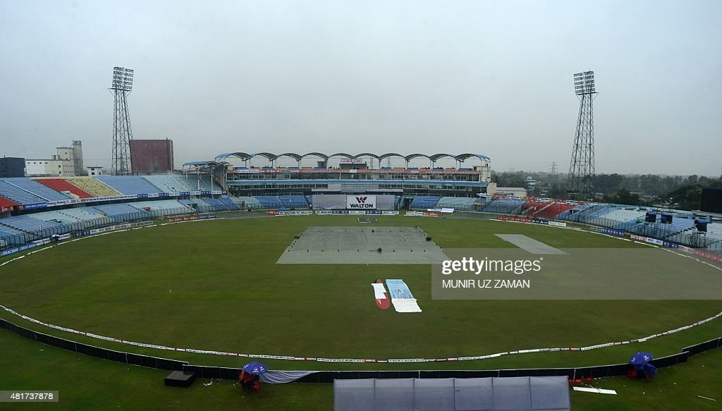 A general view shows covers on the playing surface of The Zahur Ahmed Chowdhury Stadium in Chittagong on July 24 as rain stops play during the fourth...