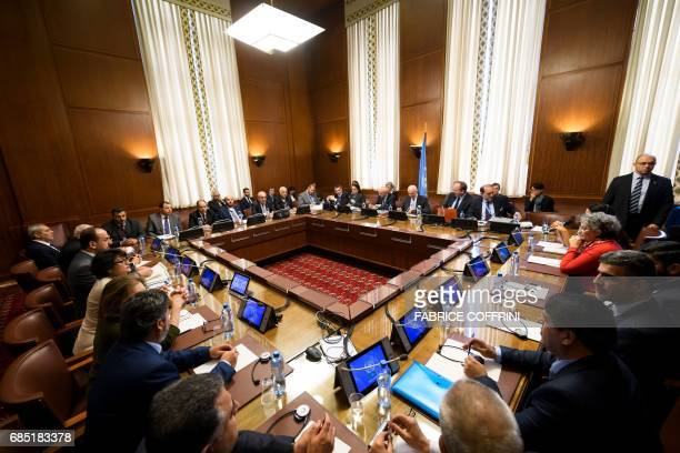 A general view shows delegates attending a meeting of Syria's main opposition High Negotiations Committee with the UN Special Envoy for Syria during...