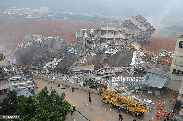 A general view shows destroyed buildings after a landslide hit an industrial park in Shenzhen south China's Guangdong province on December 20 2015 A...