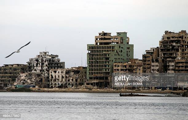 A general view shows destroyed buildings in Libya's eastern coastal city of Benghazi on October 20 2015 Clashes between soldiers of Libya's...