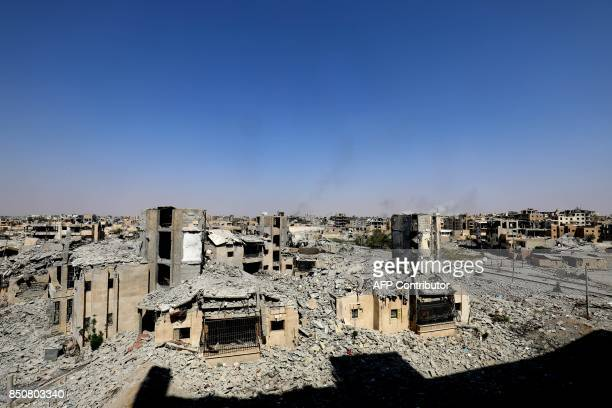 A general view shows destruction in the former Islamic State group stronghold of Raqa on September 21 as Syrian fighters backed by US special forces...