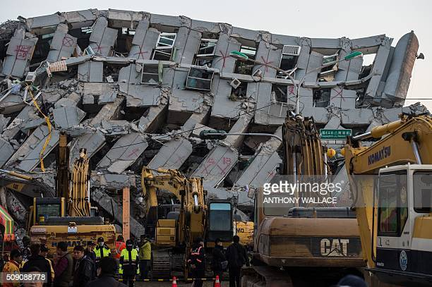 A general view shows excavator vehicles and rescue workers in front of a building which collapsed in the 64 magnitude earthquake in the southern...