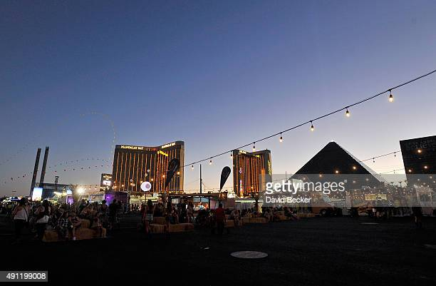 A general view shows fans attending the Route 91 Harvest country music festival at the Las Vegas Village with the Mandalay Bay Resort and Casino and...