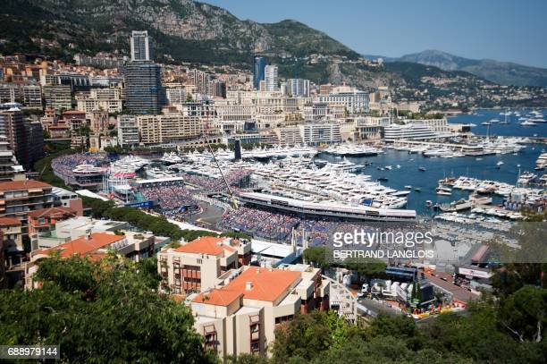 A general view shows Ferrari's Finnish driver Kimi Raikkonen competing during the qualifying session at the Monaco street circuit on May 27 2017 in...