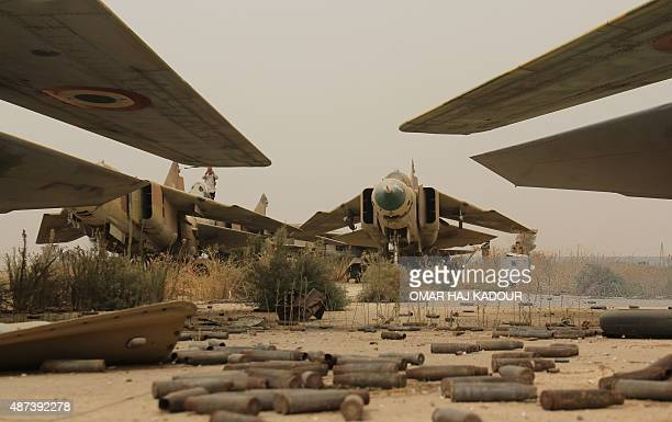A general view shows former Syrian army MiG23 fighter jets at the Abu Duhur military airport the last regimeheld military base in northwestern Idlib...
