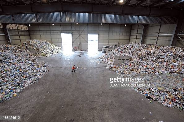 A general view shows garbage in a recycling plant of waste ValorPôle 72 on April 12 2013 in Le Mans western France ValorPôle 72 is a regional Ecopôle...