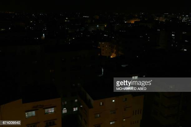 A general view shows Gaza City in the evening hours during a power cut on April 27 2017 Hit by the bitter rivalry between the strip's Islamist Hamas...