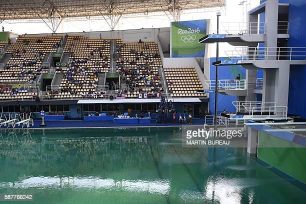 A general view shows green water in the pool before the Women's Synchronised 10m Platform Final as part of the diving event at the Rio 2016 Olympic...