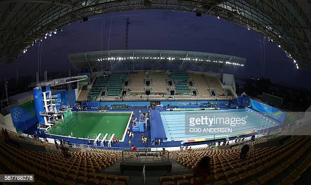 A general view shows green water in the pool of the diving event before the Women's Synchronised 10m Platform Final at the Rio 2016 Olympic Games at...