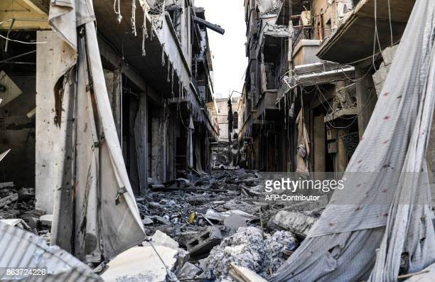 TOPSHOT A general view shows heavily damaged buildings in Raqa on October 20 after a Kurdishled force expelled the Islamic State group from the...