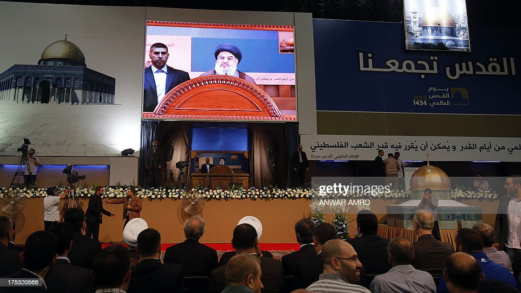 A general view shows Hezbollah's chief Hassan Nasrallah delivering a speech during a rare public appearance at a gathering to mark the 'Al-Quds (Jerusalem) International Day' from Beirut's southern suburb neighbourhood of Rweiss on August 2, 2013. It was a first appearance in public since last September for Nasrallah, public enemy number one for Israel and a staunch ally of Syrian President Bashar al-Assad whose troops have been battling an insurgency since 2011.