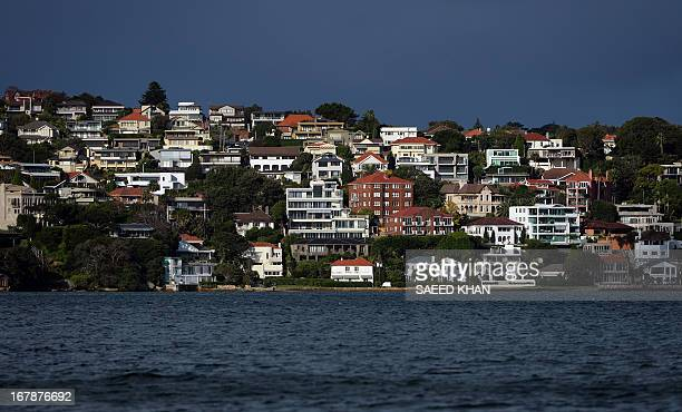 A general view shows houses lining the coast of Sydney harbour on May 2 2013 According to a report the number of Australian home building permits...