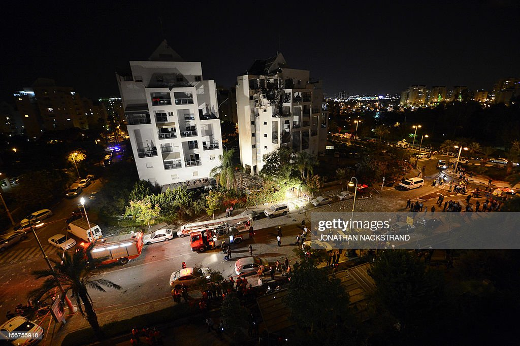 A general view shows Israeli emergency services inspecting a destroyed house that was hit by a rocket, fired from Gaza, in the city of Rishon Letzion, near Tel Aviv, on November 20, 2012. Israeli Prime Minister Benjamin Netanyahu told Gaza's Hamas leaders to choose between peace and 'the sword' as a diplomatic push intensified to end a week of violence in and around the strip.