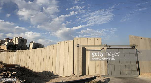 A general view shows Israel's controversial separation barrier in the the West Bank village of AlZaayem on May 6 2015 The Israeli army closed a main...