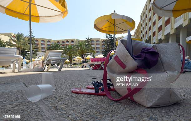 A general view shows items belonging to tourists at the swimming pool at the Thalasso Spa hotel in the resort town of Sousse a popular tourist...