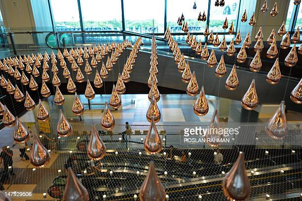 A general view shows Kinetic Rain reportedly the world's largest kinetic art sculpture hanging in the departure checkin hall in Singapore's Changi...