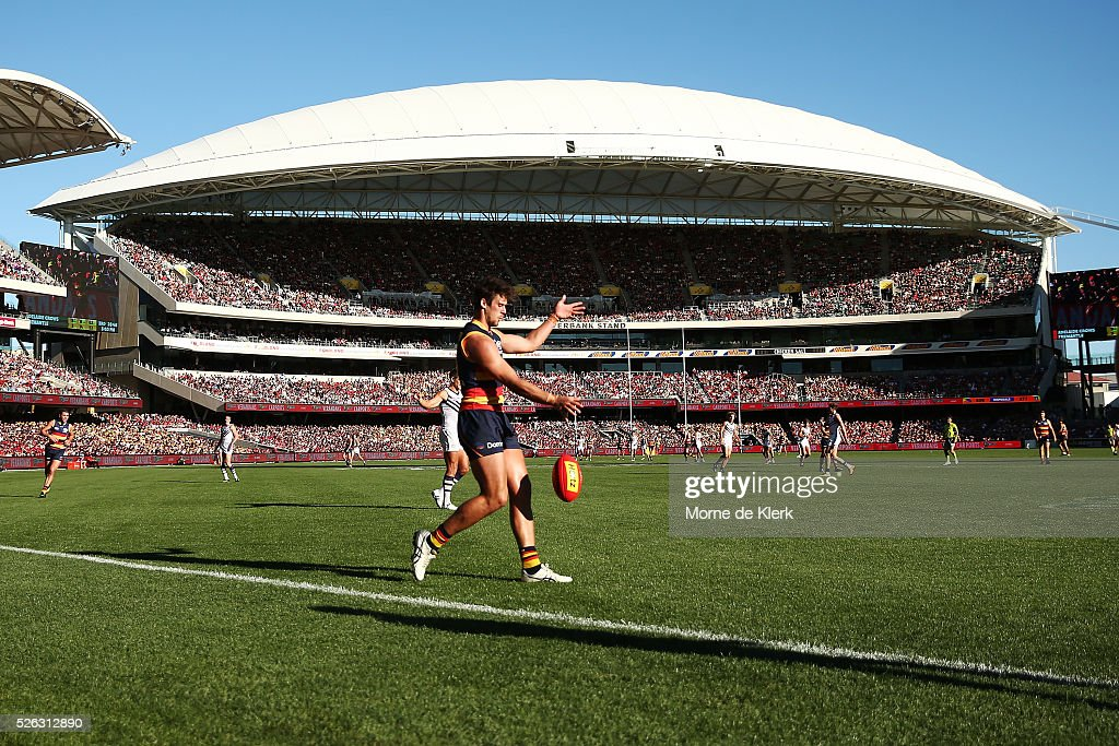 A general view shows Kyle Hartigan of the Crows kicking the ball during the round six AFL match between the Adelaide Crows and the Fremantle Dockers at Adelaide Oval on April 30, 2016 in Adelaide, Australia.