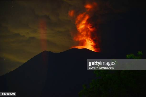 A general view shows Mount Agung erupting seen at night from Kubu subdistrict in Karangasem Regency on Indonesia's resort island of Bali on November...