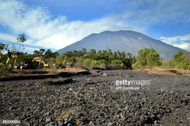 A general view shows Mount Agung from Karangasem on the Indonesian resort island of Bali on September 23 2017 Authorities have raised alert levels...