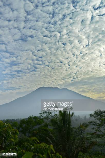 A general view shows Mount Agung from Karangasem on the Indonesian resort island of Bali on September 24 2017 Authorities have raised alert levels...