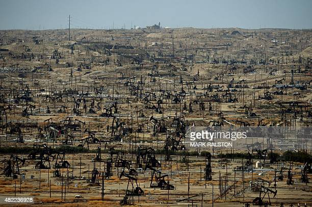 A general view shows oil pumping jacks and drilling pads at the Kern River Oil Field where the principle operator is the Chevron Corporation in...