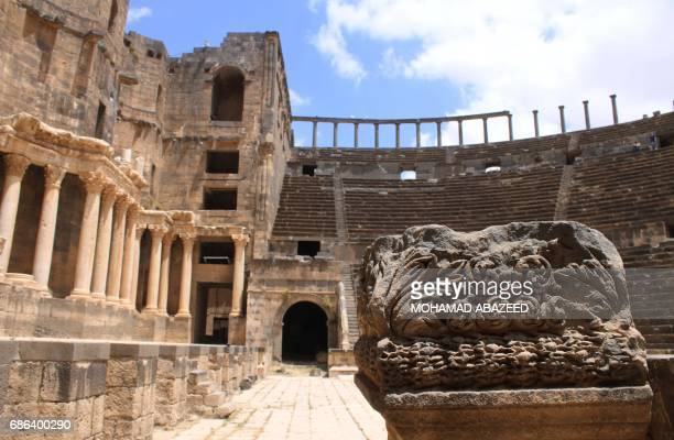 A general view shows part of the ancient Roman amphitheatre of Bosra alSham which is listed as a UNESCO World heritage site in the southern Syrian...