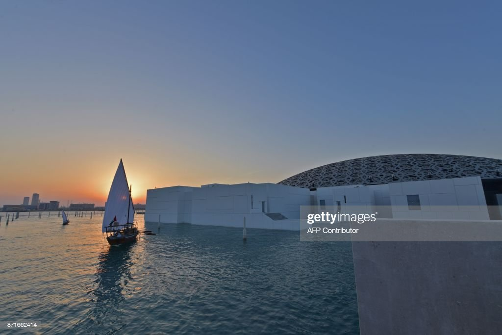 A general view shows part of the Louvre Abu Dhabi Museum designed by French architect Jean Nouvel on November 8, 2017 prior to the inauguration of the museum on Saadiyat island in the Emirati capital. More than a decade in the making, the Louvre Abu Dhabi is opening its doors bringing the famed name to the Arab world for the first time. / AFP PHOTO / Giuseppe CACACE