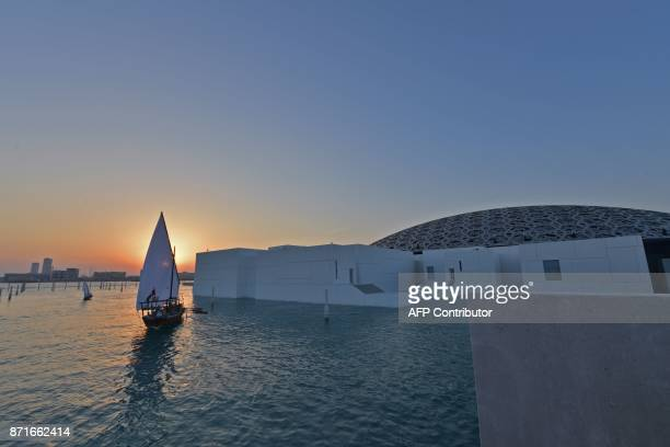 A general view shows part of the Louvre Abu Dhabi Museum designed by French architect Jean Nouvel on November 8 2017 prior to the inauguration of the...