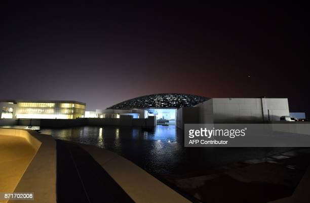 A general view shows part of the Louvre Abu Dhabi Museum designed by French architect Jean Nouvel on November 8 2017 during its inauguration on...