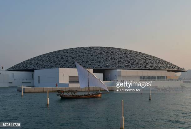 A general view shows part of the Louvre Abu Dhabi Museum designed by French architect Jean Nouvel on November 11 2017 during its official opening to...
