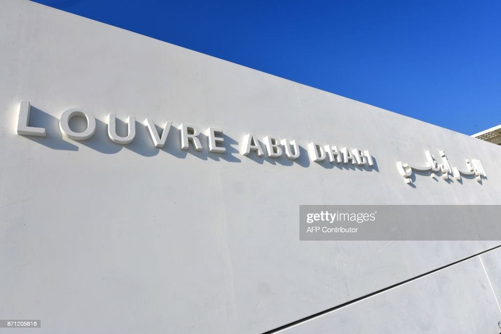 A general view shows part of the Louvre Abu Dhabi Museum on November 7, 2017 on the eve of the official opening of the museum on Saadiyat island in the Emirati capital. More than a decade in the making, the Louvre Abu Dhabi opens its doors this week, bringing the famed name to the Arab world for the first time. The museum currently has some 300 pieces on loan, including an 1887 self-portrait by Vincent van Gogh and Leonardo da Vinci's 'La Belle Ferronniere'. CACACE