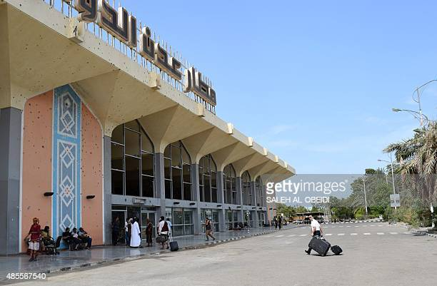 A general view shows passengers gathering at the main gate of Aden's international airport in the southern city of Aden on August 28 2015 The Yemeni...