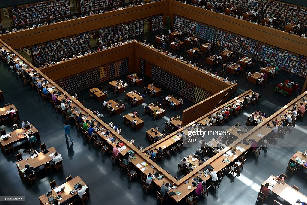 A general view shows people at a national library in Beijing on May 30, 2013. China's ruling Communist Party has called for greater political instruction for young university teachers, the education ministry has said.