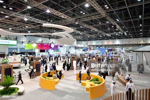 A general view shows people visiting the Gitex 2017 exhibition at the Dubai World Trade Center in Dubai on October 8 2017 / AFP PHOTO / GIUSEPPE...