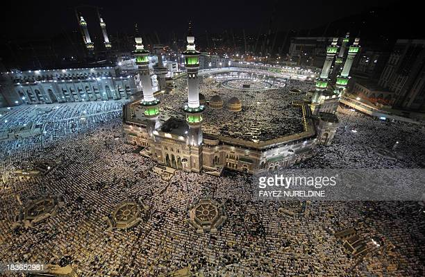 A general view shows pilgrims performing evening prayers in Mecca's Grand Mosque on October 8 as more than two million Muslims have arrived in the...