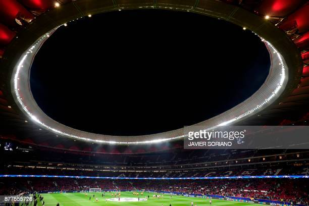 A general view shows players warming up ahead of the UEFA Champions League group C football match between Atletico Madrid and AS Roma at the Wanda...