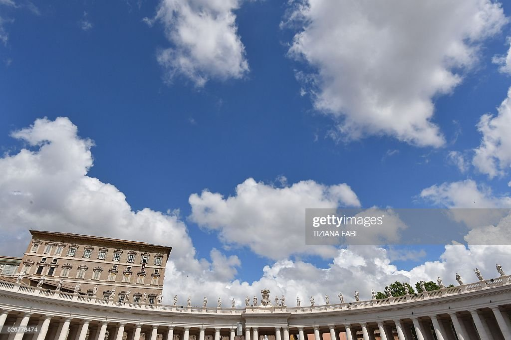 A general view shows Pope Francis addressing the crowd from the window of the apostolic palace overlooking St.Peter's square during his Sunday Angelus prayer on May 1, 2016 at the Vatican.