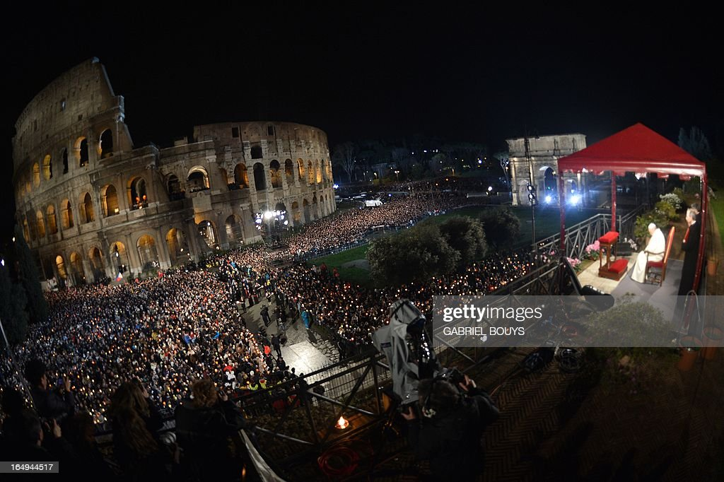 A general view shows Pope Francis (R) and the crowd during the celebration of the Way of the Cross on Good Friday on March 29, 2013 at the Colosseum in Rome. Pope Francis presided over his first Good Friday which will culminate in a torch-lit procession at Rome's Colosseum and prayers for peace in a Middle East 'torn apart by injustice and conflicts'.